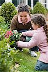 Mother and daughter gardening Stock Photo - Premium Royalty-Free, Artist: ableimages, Code: 6114-06590641