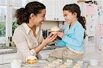 Mother and daughter with cake Stock Photo - Premium Royalty-Free, Artist: Blend Images, Code: 6114-06590646