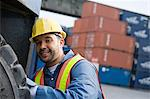 Man working at container terminal Stock Photo - Premium Royalty-Free, Artist: Blend Images, Code: 6114-06590746