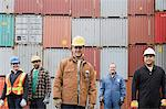 Colleagues at container terminal Stock Photo - Premium Royalty-Free, Artist: Westend61, Code: 6114-06590750