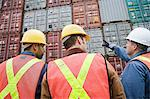 Men at container terminal Stock Photo - Premium Royalty-Free, Artist: Blend Images, Code: 6114-06590752