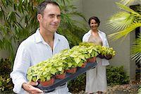 Couple with plants Stock Photo - Premium Royalty-Freenull, Code: 6114-06590867