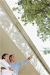 Couple on balcony Stock Photo - Premium Royalty-Free, Artist: Westend61, Code: 6114-06590873