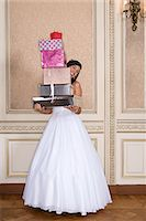 Girl with quinceanera gifts Stock Photo - Premium Royalty-Freenull, Code: 6114-06590895