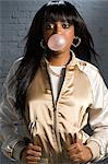 Young woman blowing bubble gum Stock Photo - Premium Royalty-Free, Artist: Blend Images, Code: 6114-06591010