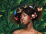 Woman with butterflies in her hair Stock Photo - Premium Royalty-Freenull, Code: 6114-06591062