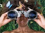 Woman looking through binoculars Stock Photo - Premium Royalty-Free, Artist: Minden Pictures, Code: 6114-06591074