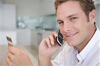 person on phone with credit card - A man telephone banking Stock Photo - Premium Royalty-Freenull, Code: 6114-06591105