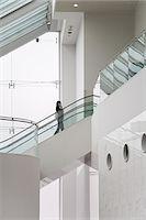 Woman on escalator Stock Photo - Premium Royalty-Freenull, Code: 6114-06591152