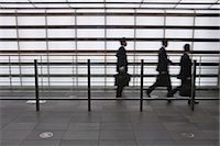 Businessmen walking fast Stock Photo - Premium Royalty-Freenull, Code: 6114-06591156