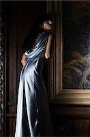 silky - Hispanic woman standing near a painting Stock Photo - Premium Royalty-Freenull, Code: 6114-06591270