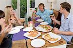 Flatmates having pizza Stock Photo - Premium Royalty-Free, Artist: ableimages, Code: 6114-06591321