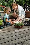A mother and daughter and gardening Stock Photo - Premium Royalty-Free, Artist: Blend Images, Code: 6114-06591457