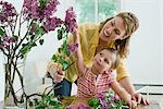 A mother and daughter flower arranging Stock Photo - Premium Royalty-Free, Artist: Westend61, Code: 6114-06591458