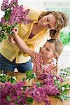 A mother and daughter flower arranging Stock Photo - Premium Royalty-Free, Artist: Westend61, Code: 6114-06591465