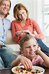 A family watching tv Stock Photo - Premium Royalty-Free, Artist: photo division, Code: 6114-06591469