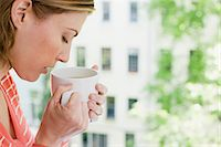 smelly - Woman smelling herbal tea Stock Photo - Premium Royalty-Freenull, Code: 6114-06591471
