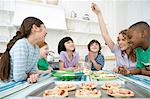 Children making pizzas Stock Photo - Premium Royalty-Free, Artist: Westend61, Code: 6114-06591594