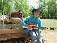 Cowboy with a guitar Stock Photo - Premium Royalty-Freenull, Code: 6114-06591615