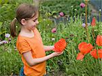 A girl holding a poppy Stock Photo - Premium Royalty-Freenull, Code: 6114-06591674