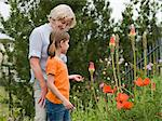 A grandmother and granddaughter in a garden Stock Photo - Premium Royalty-Freenull, Code: 6114-06591677