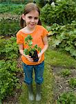A girl holding a plant Stock Photo - Premium Royalty-Freenull, Code: 6114-06591686