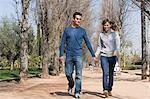 Couple walking hand in hand Stock Photo - Premium Royalty-Free, Artist: Minden Pictures, Code: 6114-06591774