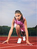 race track (people) - A runner on the starting line Stock Photo - Premium Royalty-Freenull, Code: 6114-06591801