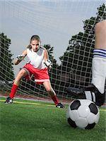 preteen girl - A goalkeeper in goal Stock Photo - Premium Royalty-Freenull, Code: 6114-06591806