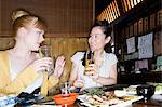 Friends talking in a bar Stock Photo - Premium Royalty-Free, Artist: Chris Hendrickson, Code: 6114-06591820