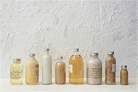 Row of cosmetics bottles Stock Photo - Premium Royalty-Freenull, Code: 6114-06591825