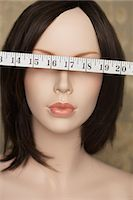 Mannequin with tape measure over eyes Stock Photo - Premium Royalty-Freenull, Code: 6114-06591839