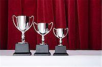 Three silver trophies Stock Photo - Premium Royalty-Freenull, Code: 6114-06591865