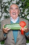 Senior man with winning marrow Stock Photo - Premium Royalty-Freenull, Code: 6114-06591871