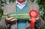 Man holding a winning marrow Stock Photo - Premium Royalty-Freenull, Code: 6114-06591878