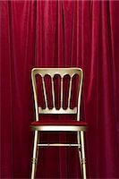 red chair - Golden chair and red curtains Stock Photo - Premium Royalty-Freenull, Code: 6114-06591882