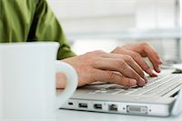 Hands typing on a laptop computer Stock Photo - Premium Royalty-Freenull, Code: 6114-06591936