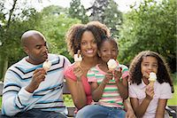 Family in park with ice creams Stock Photo - Premium Royalty-Freenull, Code: 6114-06591945