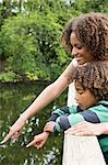 Mother and son looking at lake Stock Photo - Premium Royalty-Free, Artist: Blend Images, Code: 6114-06591950