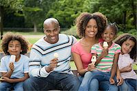 Family in park with ice creams Stock Photo - Premium Royalty-Freenull, Code: 6114-06591961
