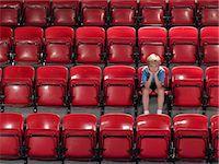 sad child sitting - Boy alone in stadium Stock Photo - Premium Royalty-Freenull, Code: 6114-06592048