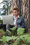 Portrait of a man using a laptop Stock Photo - Premium Royalty-Free, Artist: AWL Images, Code: 6114-06592121