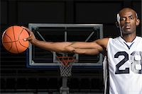 Basketball player with basketball Stock Photo - Premium Royalty-Freenull, Code: 6114-06592170