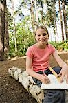 Girl drawing in forest Stock Photo - Premium Royalty-Free, Artist: Cultura RM, Code: 6114-06592243