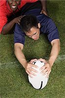 people falling - A rugby player scoring a try Stock Photo - Premium Royalty-Freenull, Code: 6114-06592290