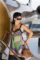 Glamorous woman by private airplane Stock Photo - Premium Royalty-Freenull, Code: 6114-06592474