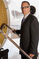 Businessman boarding jet Stock Photo - Premium Royalty-Freenull, Code: 6114-06592478