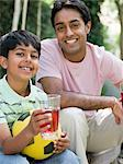 Father and son with drinks Stock Photo - Premium Royalty-Free, Artist: Robert Harding Images, Code: 6114-06592506