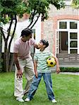 Father and son in garden Stock Photo - Premium Royalty-Free, Artist: Blend Images, Code: 6114-06592515