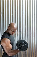 A man weightlifting Stock Photo - Premium Royalty-Freenull, Code: 6114-06592658